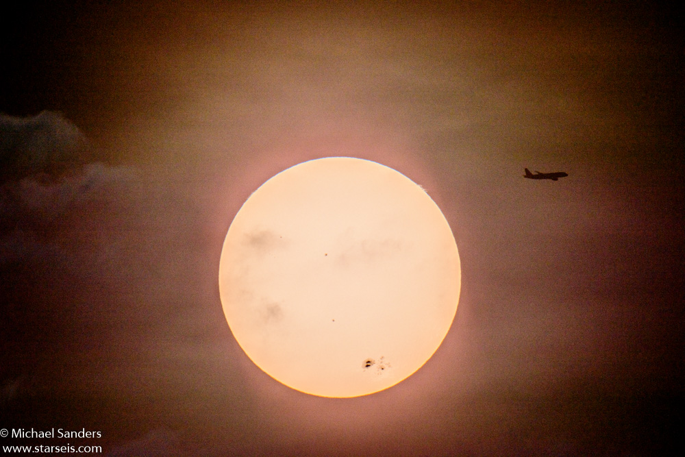 Plane in front of Sun
